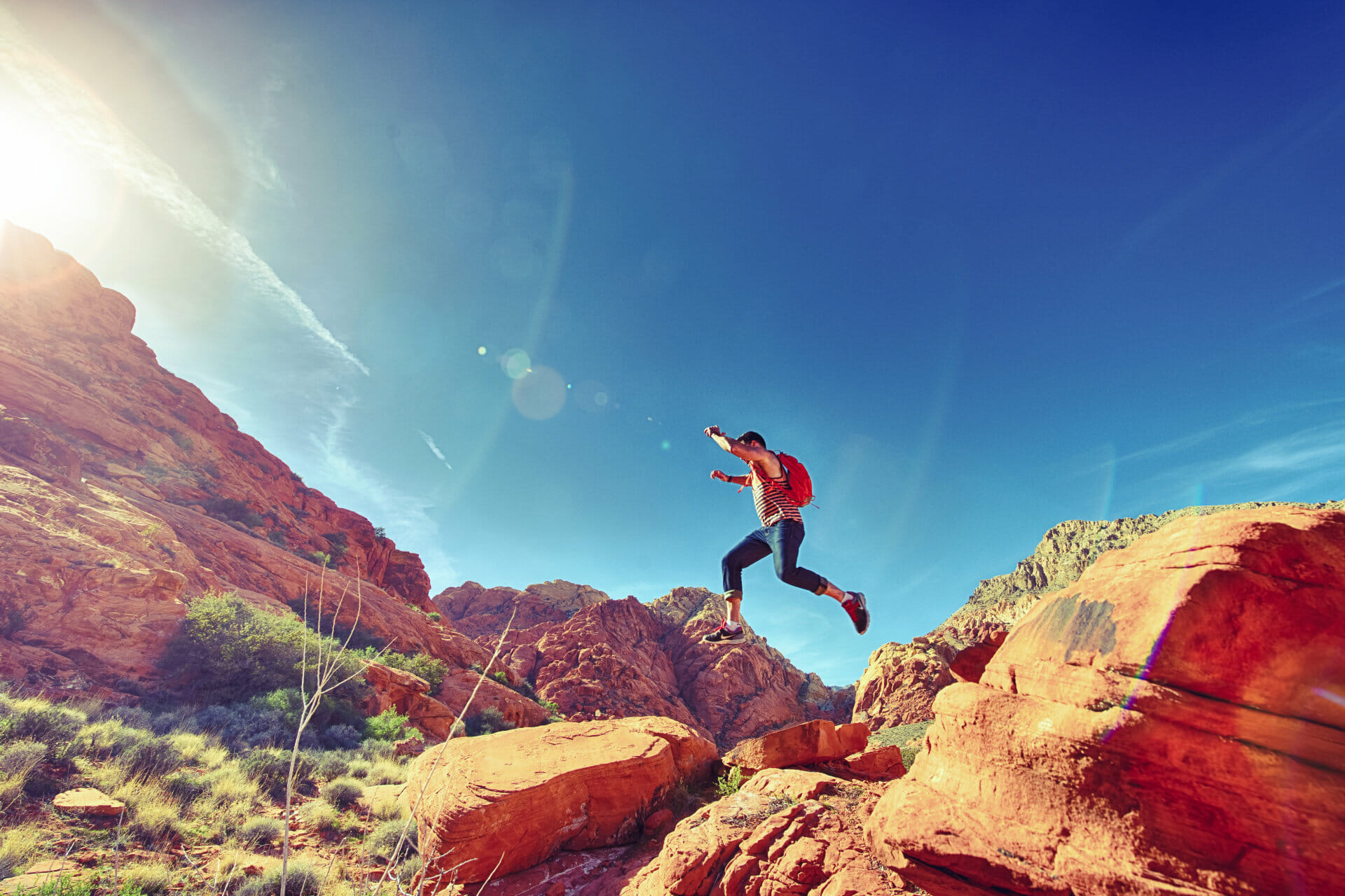 No regrets quotes and quotes on living life with no regrets - Man jumping over rock formation