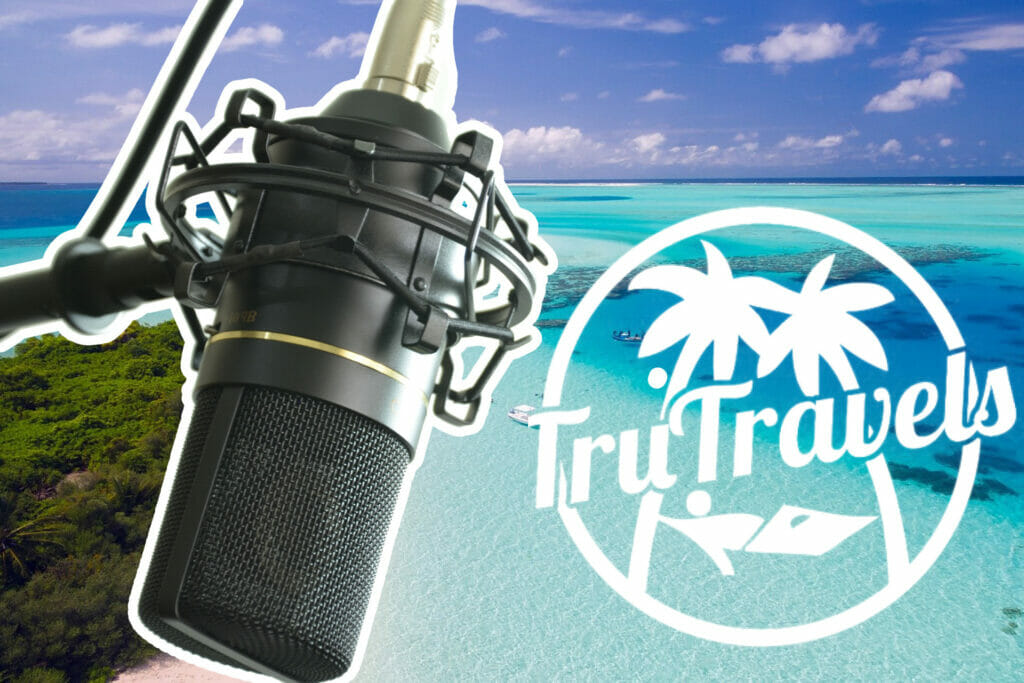 TruTravels interview with entrepreneur business owner microphone beach and TruTravel logo